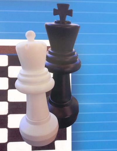 Large chess pieces for use on an outdoor playing surface