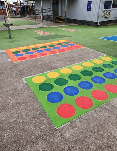An outdoor twister board with coloured dots is a great motor skills testing out a persons sense of balance, strategy and attention to given instructions.